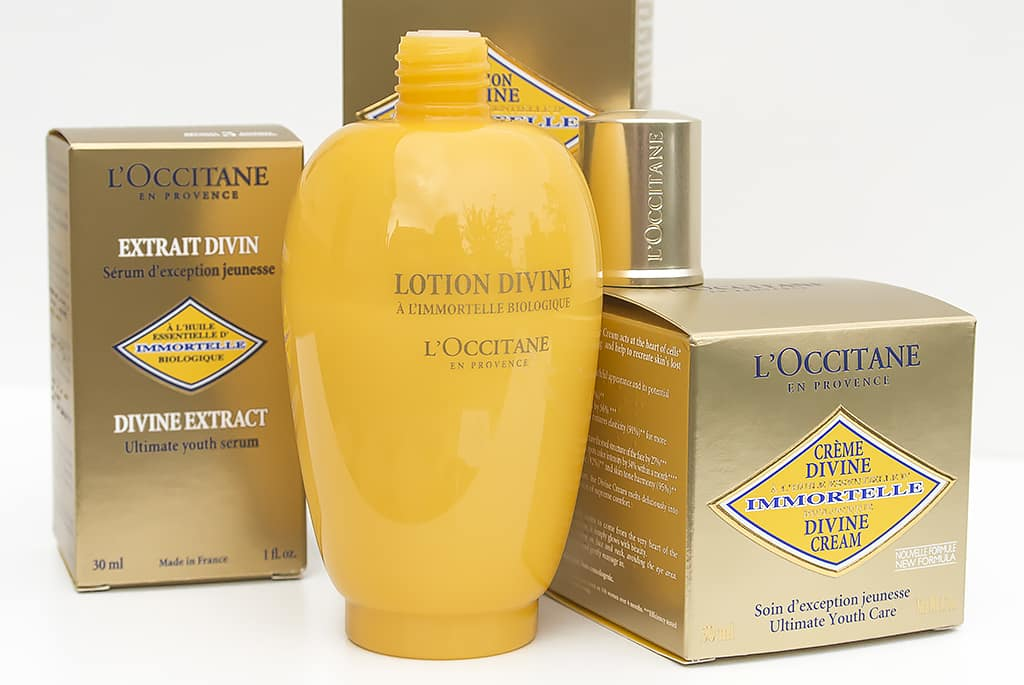 L'Occitane Divine Lotion Bottle with Lid Off and boxes