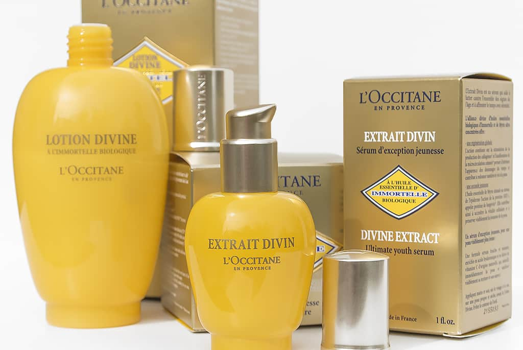 L'Occitane Divine Lotion and Extract with Lids Open and Boxes